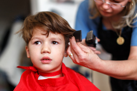 Haircut for little boy, mother cut hair for son at home