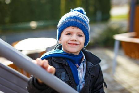 pompon: Little boy in pompon cap at winter, outdoor portrait Stock Photo