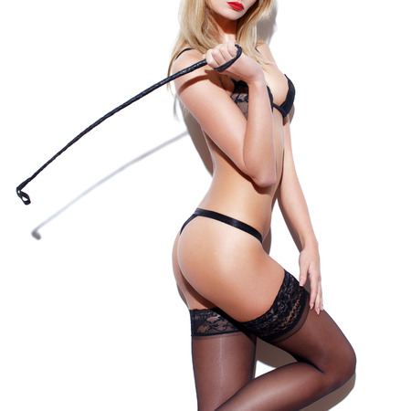 woman sex: Sexy woman body with whip at white wall Stock Photo