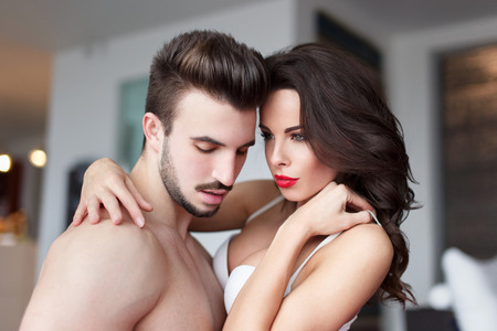 foreplay sex: Sexy young naked couple at home foreplay, sensuality