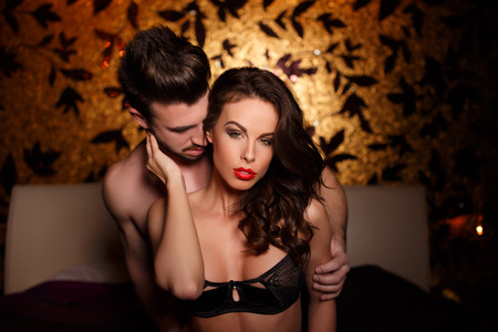 erotic sex: Sensual brunette woman in underwear with young lover, passionate couple foreplay Stock Photo