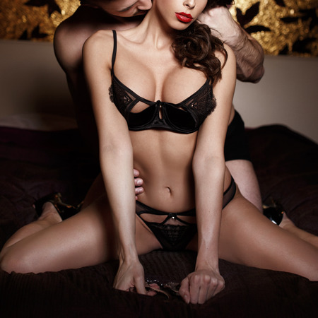 romance sex: Sexy passionate couple foreplay on bed at night, bdsm