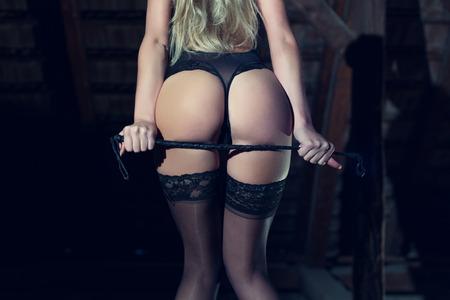 hot sex: Sexy woman ass with whip, bdsm