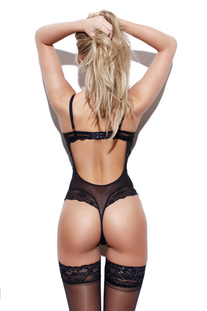 Blonde woman black in underwear, sexy ass, rear view