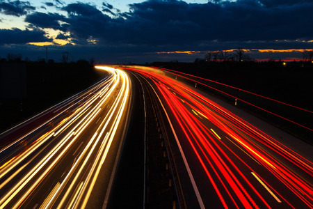 moving truck: Highway at night in long exposure with traffic Stock Photo