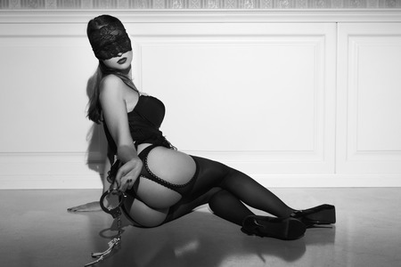 black sex: Sexy woman in underwear and lace eye cover with handcuffs posing on floor, black and white, bdsm