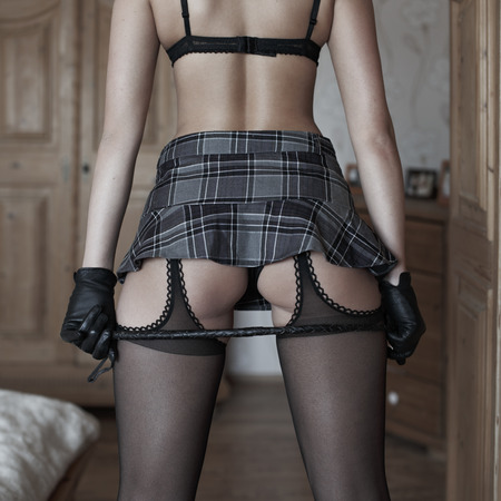 nude ass: Sexy woman ass with skirt and whip, bdsm