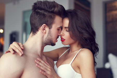 Sexy passionate couple foreplay in luxury flat, hot milf with young lover Stock Photo