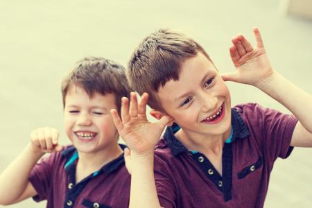 hyperactivity: Little bad boys in vintage style, outdoor portrait