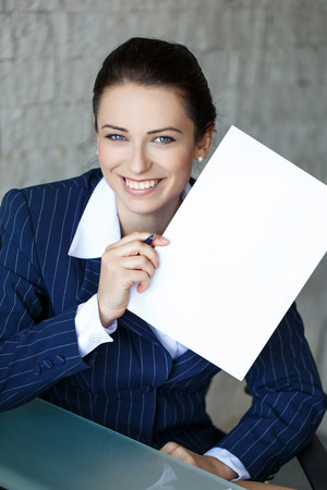 sexy teacher: Businesswoman showing black white document in office, teeth smile Stock Photo