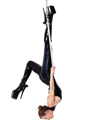 catsuit: Sexy woman in latex catsuit on aerial hoop isolated Stock Photo