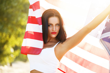 spangled: Sexy woman with usa flag outdoor star spangled banner 4th july independence day