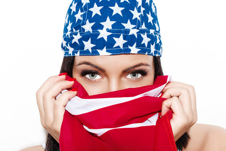 Sexy woman with huge eyes usa flag cover and headkerchief independence day Stock fotó