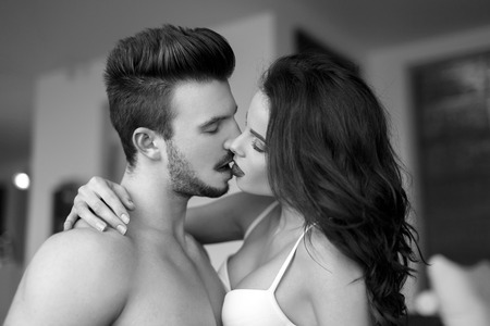 erotic couple: Sexy couple kissing at home, milf with young lover, black and white