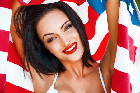 Sexy woman portrait with usa flag outdoor  4th july
