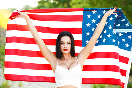 american sexy: Sexy woman holding USA flag outdoor, independence day, 4th of july