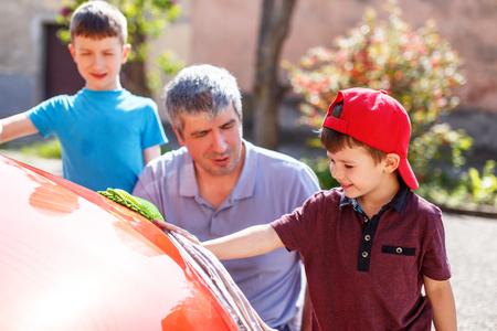 wash: Caucasian family car wash on sunny day