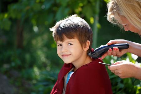 haircut: Little boy haircut outdoor portrait Stock Photo