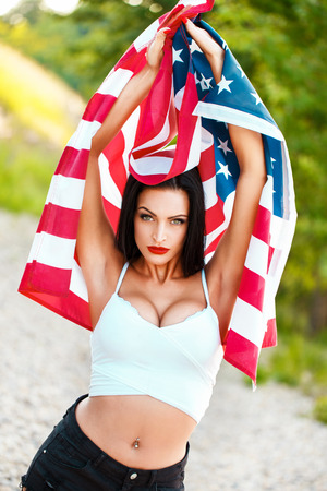 spangled: Sexy woman with usa flag outdoor star spangled banner 4th of july independence day Stock Photo