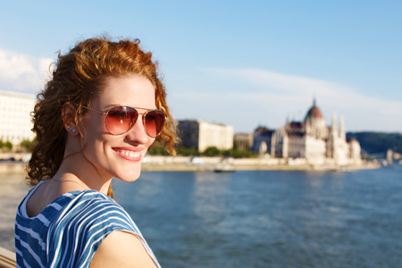 sightsee: Woman tourist in sunglasses in Budapest Hungary. Parliament and river Danube background. Stock Photo