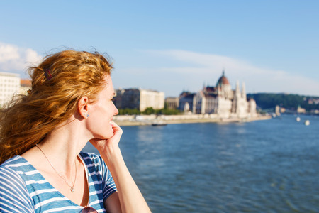 sightsee: Happy redhead woman tourist in Budapest, Hungary