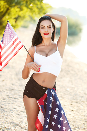 spangled: Sexy woman with usa flags outdoor, star spangled banner, 4th july, independence day