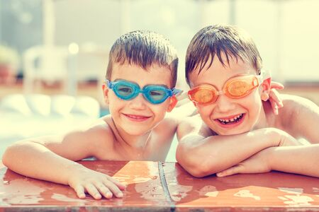 Boys laughing in pool, vintage style
