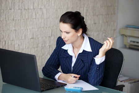 office women: Accountant surprised on bad financial balance in office Stock Photo