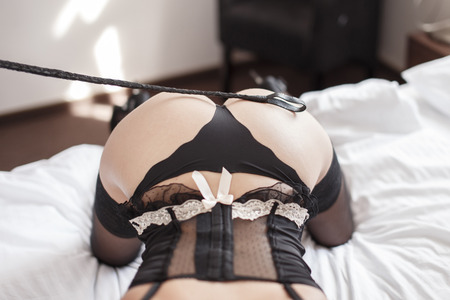 romance sex: Sexy woman with whip on ass, bdsm