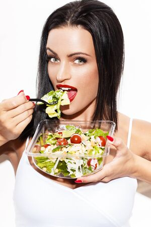 eating salad: Sexy brunette woman eating salad