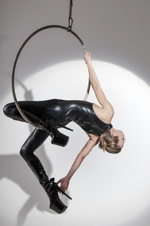 sexy dancer: Sexy dancer in latex catsuit hanging on aerial hoop