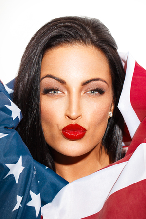 primp: Sexy woman portrait covering with USA flag primp,  4th of July Stock Photo