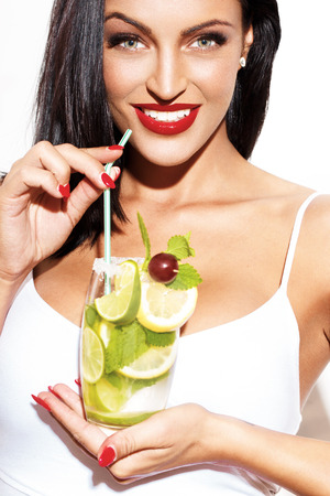 a straw: Sexy woman with red lips holding mojito, isolated on white