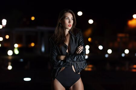 sexy black woman: Sexy young beauty woman in sexy black coat and underwear