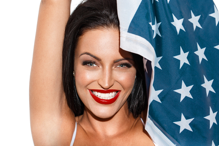 primp: Sexy brunette woman with usa flag, star spangled banner, independence day, 4th july