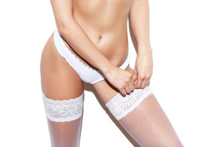 nude sexy woman: Sexy woman in underwear take off white stockings Stock Photo