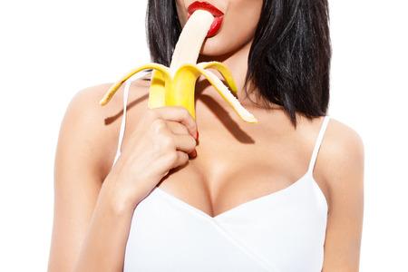 young sex: Сексуальная женщина ест банан, изолированных на белом Фото со стока