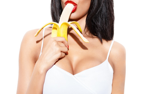 Sexy woman eating banana, isolated on white