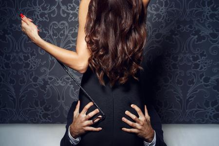 Rich businessman grip woman ass at night, bdsm Foto de archivo