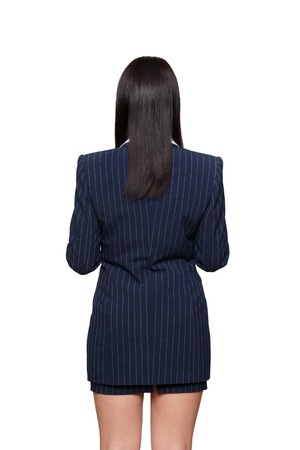 back view: Businesswoman in formal wear from behind, back view, isolated on white