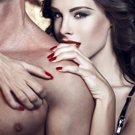 erotic sex: Sexy woman embrace naked man shoulder, bdsm Stock Photo