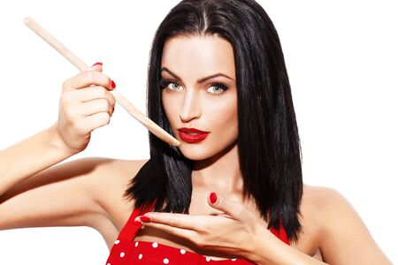 tastes: Sexy woman taste meal by wooden spoon, isolated on white