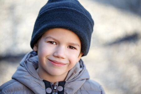 fleece: Little boy in knit cap at winter smile, outdoor portrait