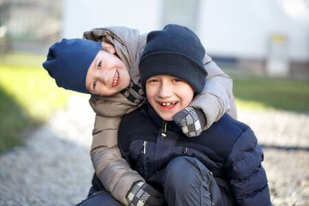knit cap: Little boys in knit cap have fun at winter, outdoor portrait