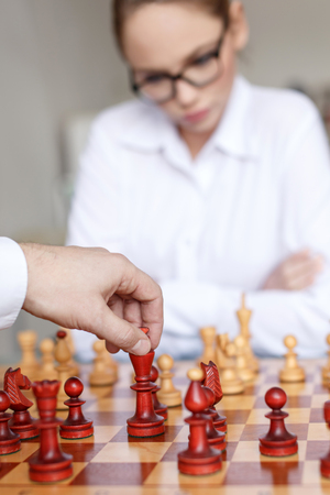 hand move: Man hand move king on chessboard, competition