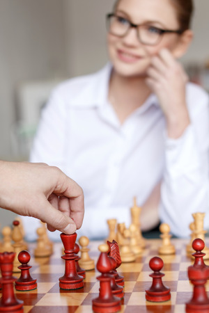 hand move: Man hand move with king on chessboard, play game with woman