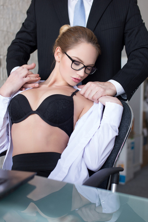 erotic: Boss undressing secretary in office, lovers Stock Photo