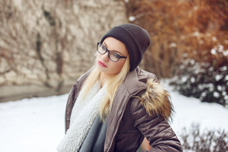 winter fashion: Portrait of fashionable hipster young woman at winter outdoor