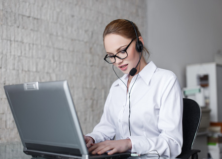 customer support: Blonde woman customer support in company, talking online Stock Photo