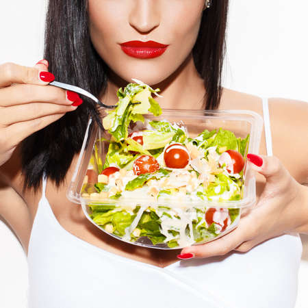 eating salad: Woman eating salad closeup, diet
